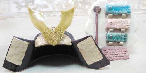 こどもの日用に作った陶器の鯉のぼりの箸置きと鎧兜